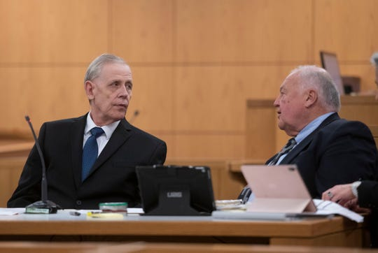 Donald Hartung, Sr.  sits in the courtroom of Circuit Judge Thomas Dannheisser on  Jan. 13, 2020, with his attorney Michael J. Griffith.  Hartung is on trial for the first-degree murder of his mother and two half-brothers in 2015.