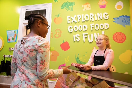Children and parents shop and play amid the aisles of a mock grocery store at the Pensacola Children's Museum on Dec. 13, 2019. The exhibit, sponsored by Publix Super Markets Charities, helps children learn basic life skills through play.