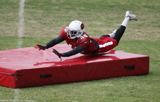 Arizona Cardinals CB Jimmy Legree dives on a mat during training camp at University of Phoenix Stadium in Glendale August 24, 2015. Legree is now in the U.S. Army.