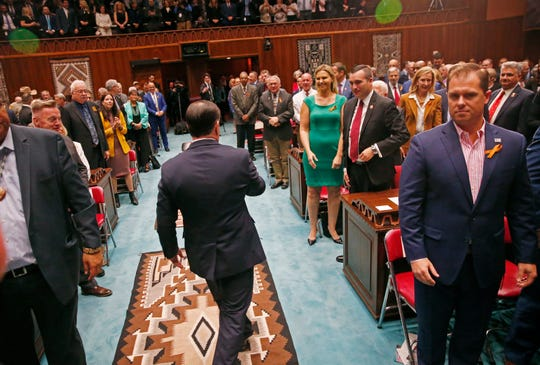 Gov. Doug Ducey walks away after his State of the State address at the Arizona state Capitol on Jan. 13, 2020.
