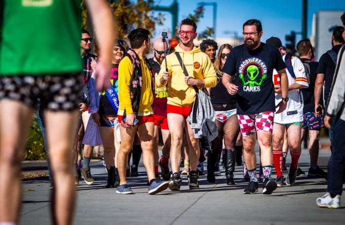 Participants in the annual No Pants Light Rail Ride walk to the mid-ride meet-up at The Churchill on Sunday, Jan. 12, 2020.