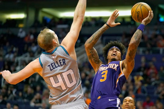 Phoenix Suns forward Kelly Oubre Jr. (3) shoots over Charlotte Hornets forward Cody Zeller during the second half of an NBA basketball game Sunday, Jan. 12, 2020, in Phoenix. Phoenix won 100-92. (AP Photo/Rick Scuteri)