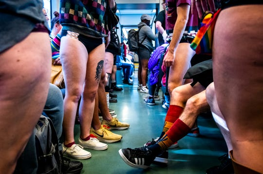 People ride the light rail without pants during the annual No Pants Light Rail Ride on Sunday, Jan. 12, 2020.