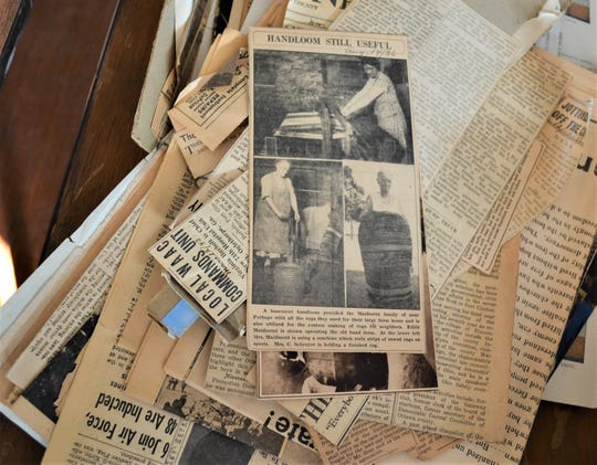 One of the many piles of newspaper stories that needs to be sorted and digitized sits in the museum annex.