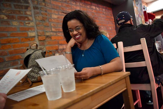 Sandra Quiñones-Hemphill of Manchester Township looks over the menu at the Cantina during the Off Grid Disaster Relief fund raising event, Sunday, January 12, 2020. 