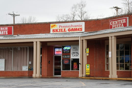 In this photo from Jan. 10, 2020, a Pennsylvania Skill games storefront is open in Monaca, Pa. A hearing is scheduled before the state's Commonwealth Court for Jan. 15, 2020, on whether Pennsylvania law prohibits the machines as unlicensed slot machines, even if a player's success is supposedly based on skill, rather than chance. (AP Photo/Keith Srakocic)
