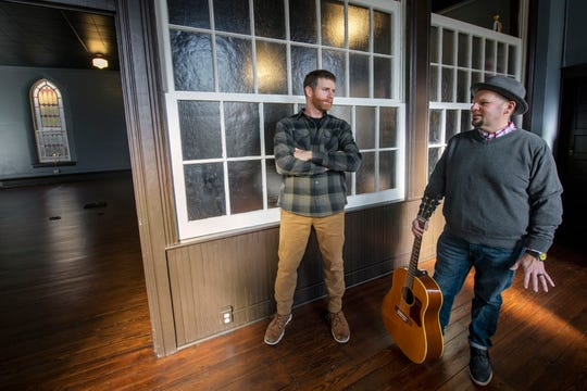 """Bryan Lazzaro, left, and Troy Engle inside a former Lutheran Church in Railroad, now and events venue, that was used to film their music video """"Haunting Me""""."""