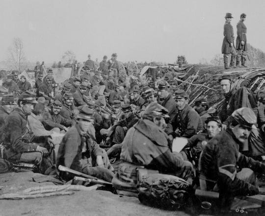Soldiers are pictured in the trenches during the Civil War.