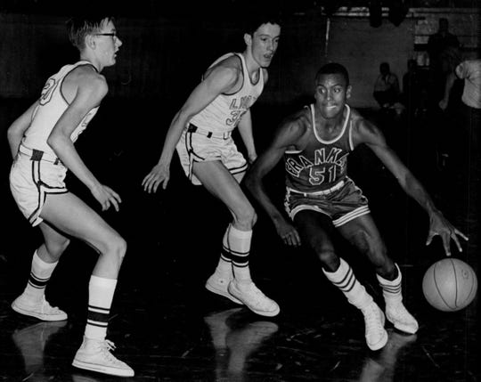 Trent Jackson of Franklin, right, dribbles past two Lyons defenders, including Jim Boeheim, left, in the 1961 Section V Class AA semifinals. Franklin won the game but lost to Webster in the championship.