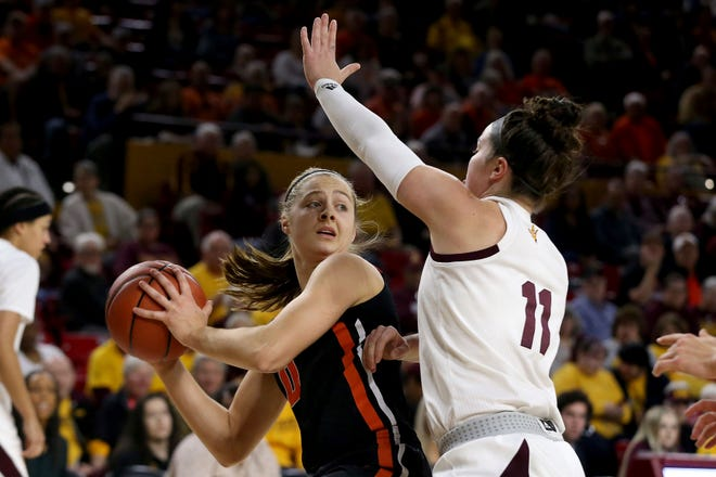 Oregon State's Mikayla Pivec (0) looks to pass against Arizona State's Robbi Ryan (11) during the first half of an NCAA college basketball game Sunday, Jan. 12, 2020, in Tempe, Ariz.