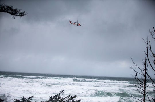 A Coast Guard helicopter continues the search for a missing boy near Falcon Cove Beach in Clastop County.