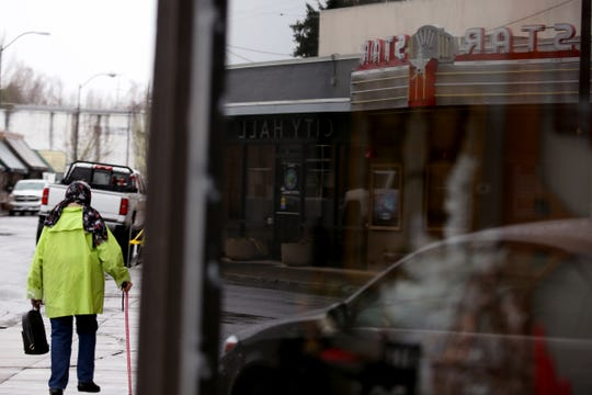 A woman walks along Third Street in downtown Stayton on Jan. 13, 2020. A proposal for an overlay district, intended to make the transition from First Street to Third Street more user friendly, was shot down by the Stayton city council.