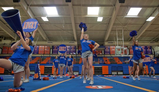 The Central High School cheerleading team rehearses a routine for an upcoming competition Thursday, Jan. 9, 2020.