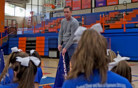 Matthew Escue, head coach of the Central High School cheerleading team, talks to members of the team during a practice Thursday, Jan. 9, 2020.