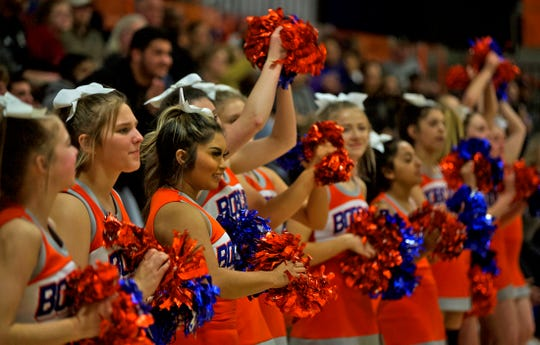 Members of the Central High School cheerleading team perform at a basketball game Friday, Jan. 10, 2020.