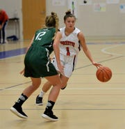 Worcester Prep's Carly Hoffman (1) dribbles the ball past a Salisbury School player on Friday, Jan. 10, 2020.