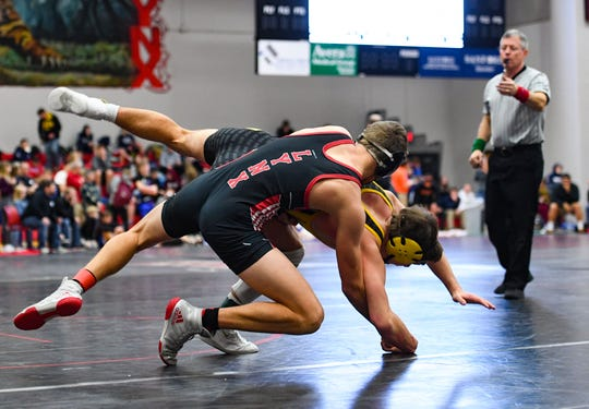 Isaac Klinkhammer of Brandon Valley tosses Jaden Dominisse of Canton onto the mat at the Brandon Valley Invitational meet on Saturday, Jan. 11, at Brandon Valley High School.