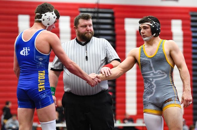 Eli Kadoun of Roosevelt shakes hands with Landry Knight of West Central following their semifinal match at the Brandon Valley Invitational meet on Saturday, Jan. 11, at Brandon Valley High School.