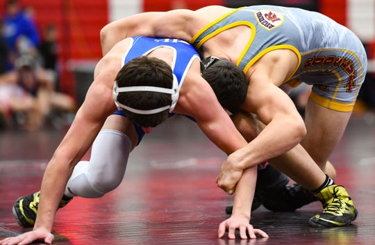 Eli Kadoun of Roosevelt holds Landry Knight of West Central while wrestling at the Brandon Valley Invitational meet on Saturday, Jan. 11, at Brandon Valley High School.