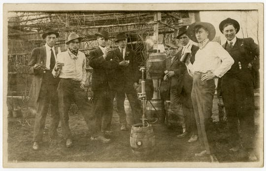 A group gathers around a Hamm's beer keg in St. Cloud, ca. 1914.