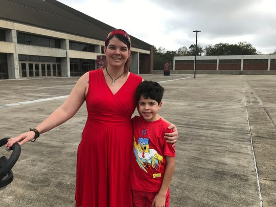 Leon County teacher Colleen Nottingham stands with her 10-year-old son, Dexter, at the Take on Tallahassee rally.