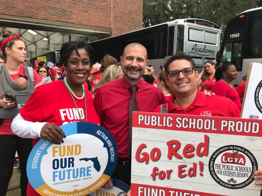 Leon County Schools Superintendent Rocky Hanna (middle) stands with Assistant Superintendent Deana McAllister (left) and President of the teacher's union, Scott Mazur (right), during the Take on Tallahassee march.