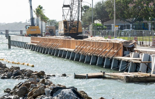The sidewalk and northbound lane of Melody Lane remain closed as work crews continue repairs to the seawall on Jan. 11, 2020, in downtown Fort Pierce. FEMA has denied the city of Fort Pierce's $1.3M reimbursement claim for seawall damage, but the state wants FEMA to reverse that decision.