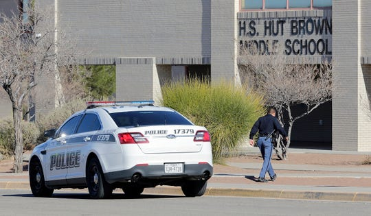 An El Paso Independent School District police officer walks toward Brown Middle School on Monday, Jan. 13, 2020, after threats were made to the campus over the weekend. The district determined the threat was not credible.