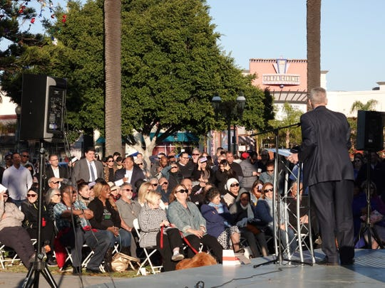 A crowd reacts as Pastor Greg Runyon speaks during the Oxnard Together event Sunday organized by the Oxnard Police Department to promote community service.