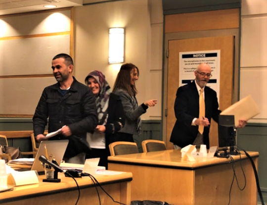 Mustafa Ozturk (left) and his wife Rahime leave a hearing in Cumberland County Superior Court on Monday. The Vineland residents were indicted last year in a food stamp fraud case. Behind them are a Turkish language interpreter for Rahime Ozturk and attorney Mark Rinkus (right), who represents the husband.