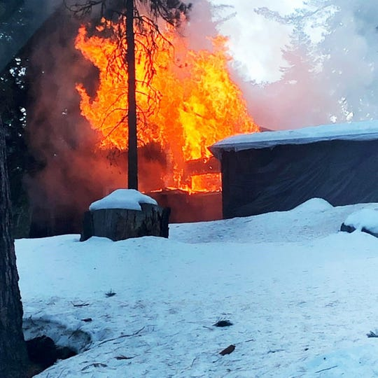 Firefighters battled a structure fire at Grant Grove Village inside Kings Canyon National Park on Friday, Jan. 10.
