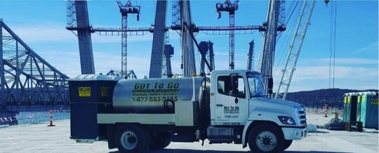 Good to Go, the portable-toilet company in Cortlandt Manor, is suing the state, the Thruway, the builders of the Gov. Mario M. Cuomo Bridge and six insurance companies over unpaid bills tied to the building of the $4 billion bridge.