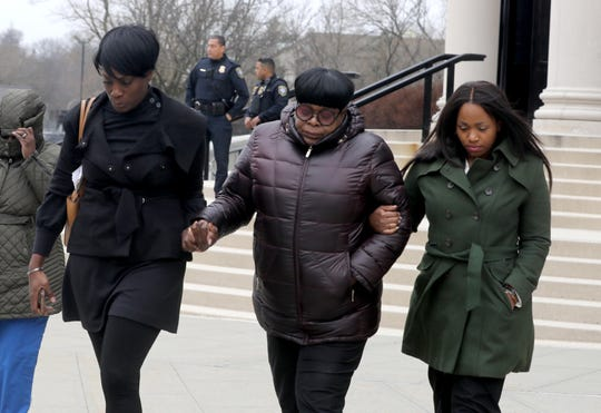 Kim Thomas, center, the mother of Grafton Thomas, the suspect in the Dec. 28, 2019, machete attack at a Monsey rabbi's home, leaves federal court in White Plains Jan. 13, 2020, after her son's court appearance. Grafton Thomas pleaded not-guilty to federal hate crimes.