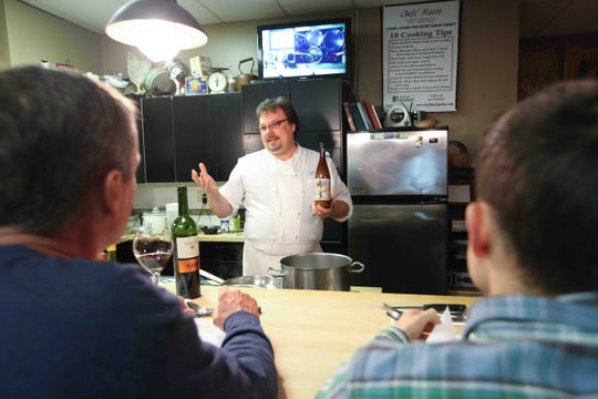 Mark Eastman, chef and owner of Chefs' Haven in Hockessin,  teaches a sold out cooking class. Eastman is now renovating the Old Lancaster Pike shop and expects to offer more gourmet and prepared foods.