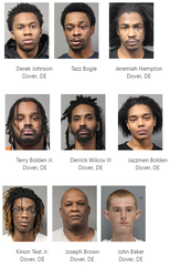 Dover police arrested nine people and seized guns and drugs Friday afternoon while executing search warrants at two S. New Street homes, the department said Monday.
