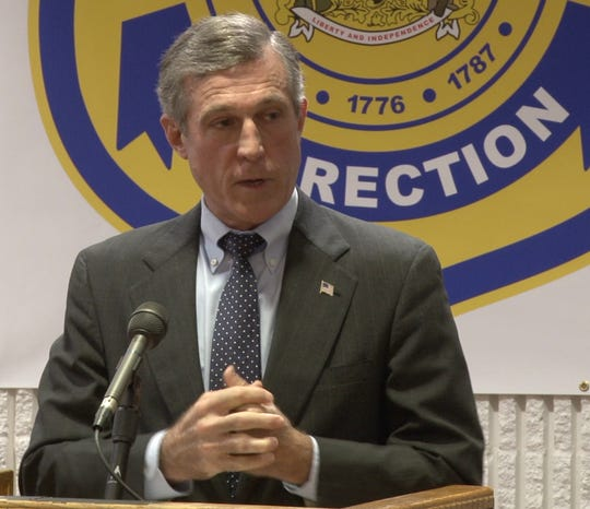 Gov. John Carney speaks at a press conference Monday at the Howard R. Young Correctional Institution.