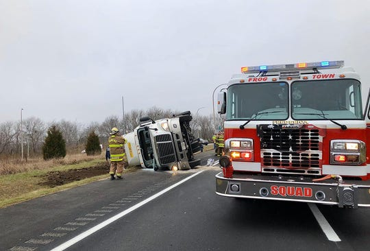 A tractor-trailer carry chickens overturned on Del. 1 near Frederica, police said.