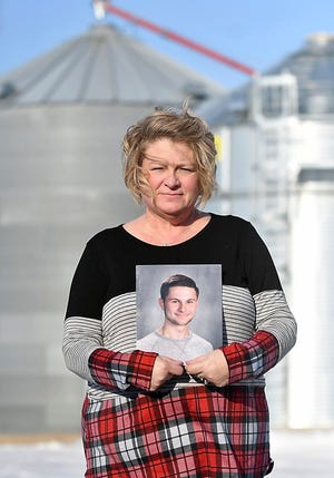 Michele Gran, shown here holding a photo of her 18-year-old son, Landon on her family's farm near Norseland, Minn., plans to advocate for more safety features in and around grain bins this legislative session after  Landon, died in August inside a grain bin two miles south of his home in Norseland. Landon is one of at least nine people who died in grain bin-related incidents since July.