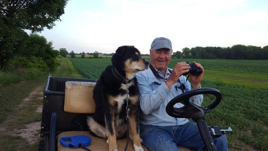 Sunny and Bob enjoying a cart ride to look for deer.