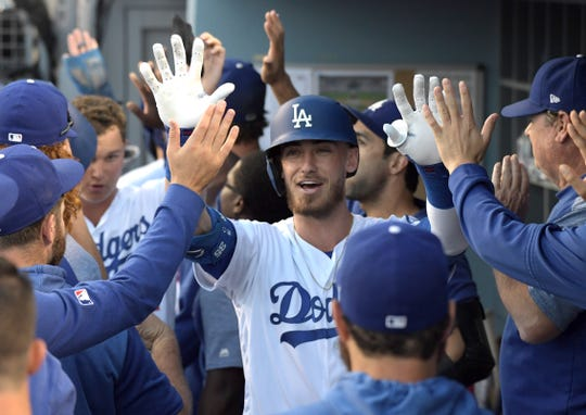 Cody Bellinger celebrates with teammates after hitting a three-run home run.