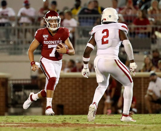 Oklahoma quarterback Spencer Rattler carriers the ball during the second half of his team's 2019 game against South Dakota at Gaylord Family - Oklahoma Memorial Stadium.