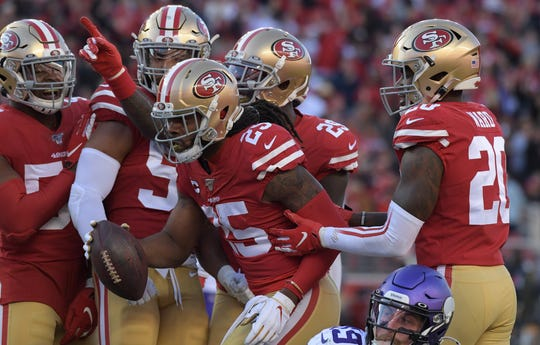 Richard Sherman celebrates after intercepting a pass against the  Vikings.