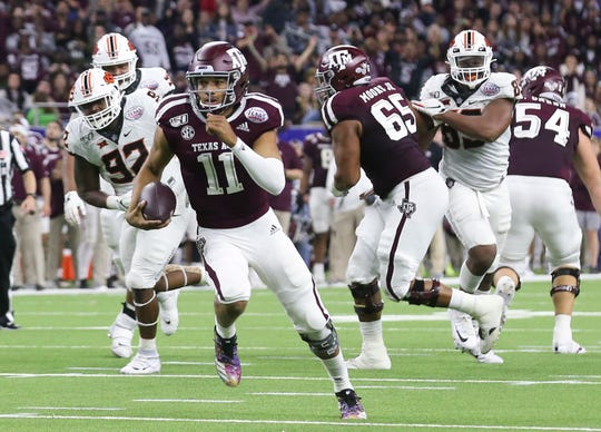 Texas A&M quarterback Kellen Mond carries the ball against Oklahoma State in the second quarter of the Texas Bowl at NRG Stadium.