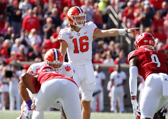 Clemson quarterback Trevor Lawrence gestures at the at the line of scrimmage during the first quarter of his team's 2019 game against Louisville at Cardinal Stadium.