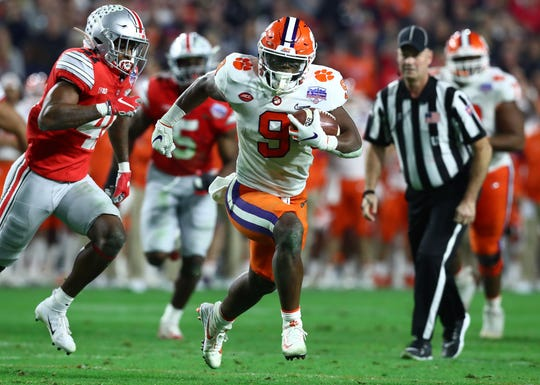 Clemson running back Travis Etienne breaks free to scores a touchdown against Ohio State during the 2019 Fiesta Bowl at State Farm Stadium.