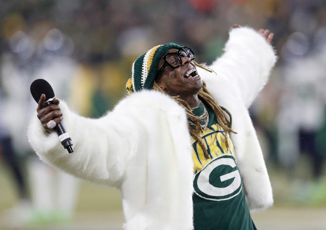 Lil Wayne addresses the crowd in the second half of a NFC Divisional Round playoff football game between the Green Bay Packers and Seattle Seahawks at Lambeau Field on Jan. 12, 2019.