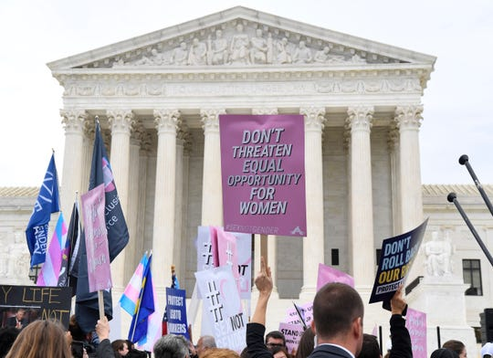 Demonstrators gathered in front of the Supreme Court on Oct. 8 as the justices heard three challenges from New York, Michigan and Georgia involving workers who claimed they were fired because they were gay or transgender.