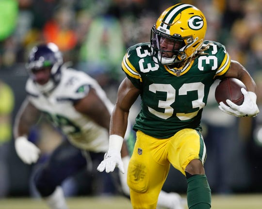 Packers running back Aaron Jones runs the ball against the Seahawks.