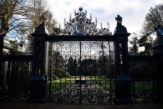 A gated entrance to Queen Elizabeth II's Sandringham estate in Norfolk on Jan. 13, 2020, as the media gathered early outside in advance of the royal summit of the queen, Prince Harry, Prince William and Prince Charles to discuss the Duke and Duchess of Sussex's future role in the family.