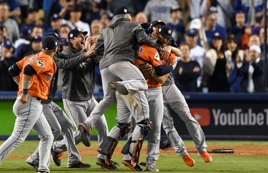 Astros players celebrate the final out of the 2017 World Series at Dodger Stadium.